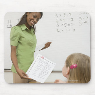 Teacher handing paper to student with A plus Mouse Pad