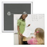 Teacher handing paper to student with A plus Pinback Button