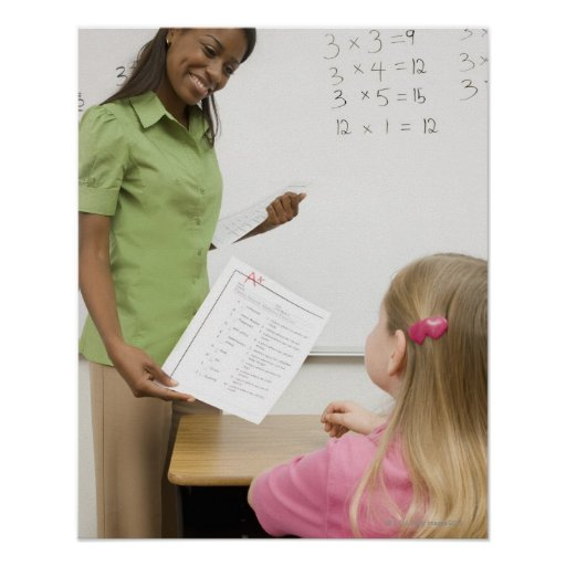 Teacher handing paper to student with A plus Poster