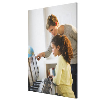 Teacher helping student in computer lab gallery wrapped canvas