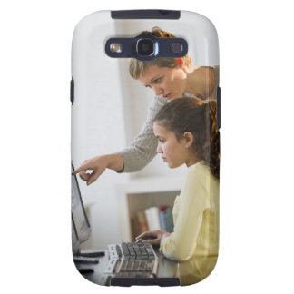 Teacher helping student in computer lab samsung galaxy s3 cases