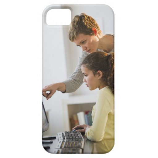 Teacher helping student in computer lab iPhone 5 case