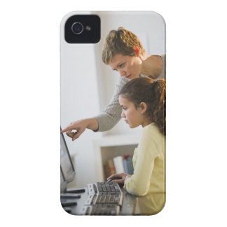 Teacher helping student in computer lab iPhone 4 Case-Mate cases