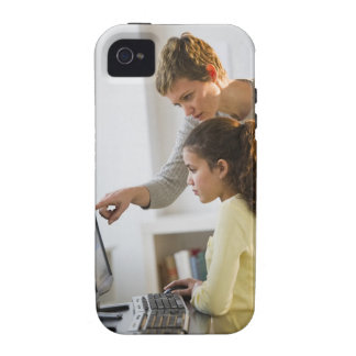 Teacher helping student in computer lab iPhone 4 case