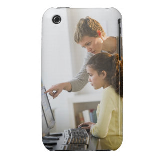 Teacher helping student in computer lab Case-Mate iPhone 3 cases