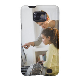 Teacher helping student in computer lab samsung galaxy s2 cases