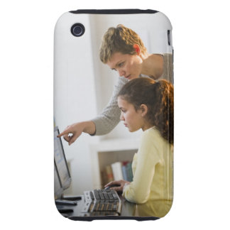 Teacher helping student in computer lab iPhone 3 tough case