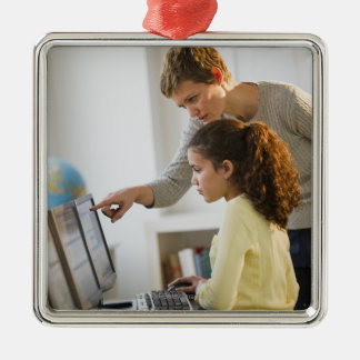 Teacher helping student in computer lab metal ornament