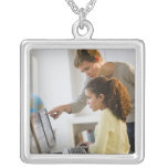 Teacher helping student in computer lab custom necklace