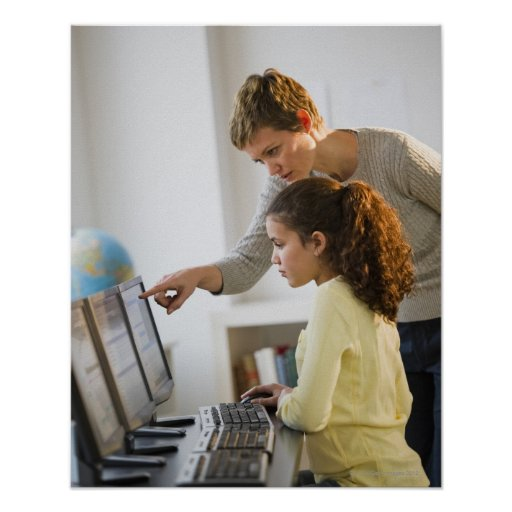 Teacher helping student in computer lab posters