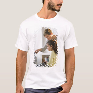 Teacher helping student in computer lab T-Shirt