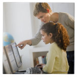 Teacher helping student in computer lab large square tile