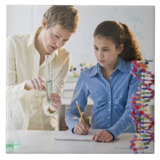 Teacher helping student in science lab ceramic tile