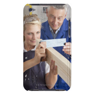 Teacher helping student measuring planed wood in barely there iPod case