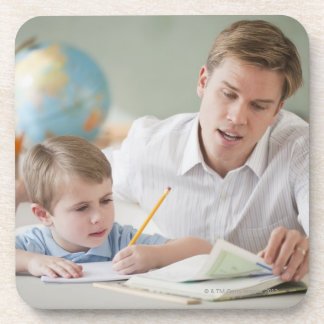 Teacher helping student with homework coasters