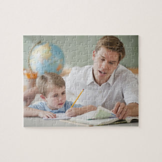 Teacher helping student with homework jigsaw puzzle