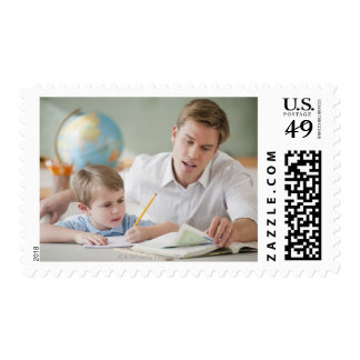 Teacher helping student with homework postage