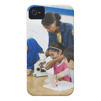 Teacher helping students use microscope in iPhone 4 Case-Mate case