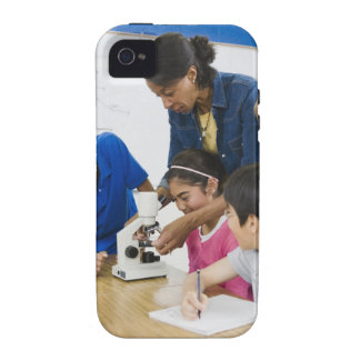 Teacher helping students use microscope in iPhone 4/4S cover