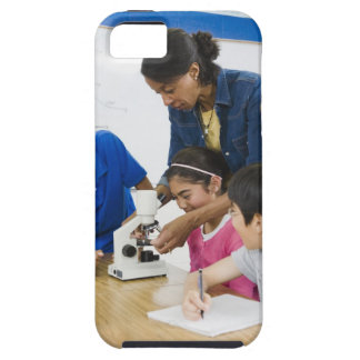 Teacher helping students use microscope in iPhone 5 case