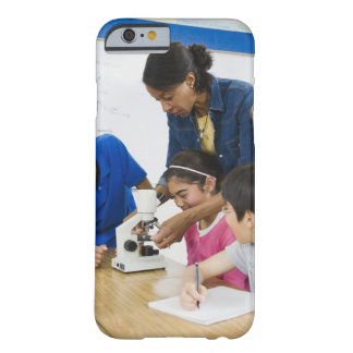 Teacher helping students use microscope in barely there iPhone 6 case