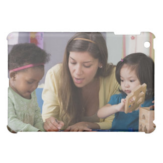 Teacher helping toddlers color at daycare case for the iPad mini