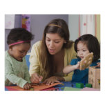 Teacher helping toddlers color at daycare print