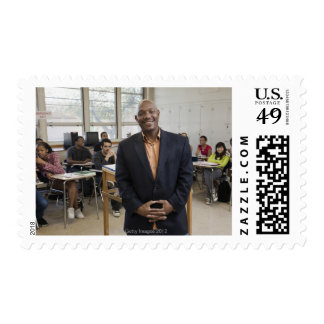 Teacher in classroom with students postage stamp