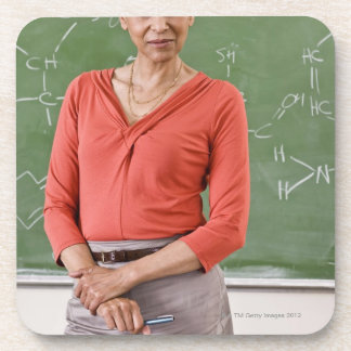 Teacher in front of chalkboard coaster