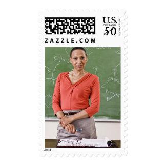 Teacher in front of chalkboard postage