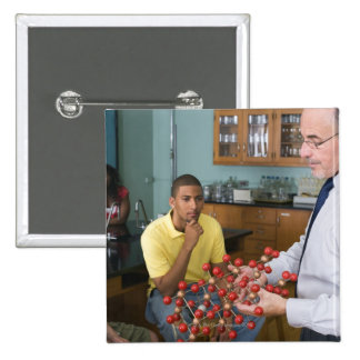 Teacher instructing students 2 inch square button