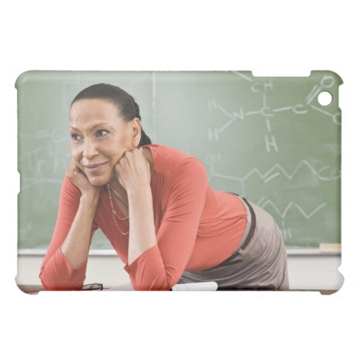 Teacher leaning on desk by chalkboard case for the iPad mini