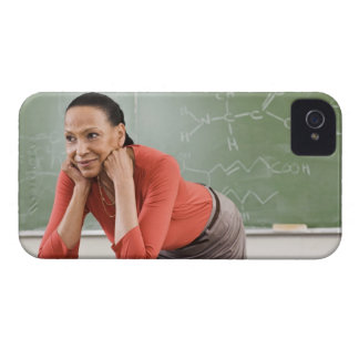 Teacher leaning on desk by chalkboard iPhone 4 cover