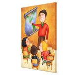 Teacher pointing to map, three children in desks stretched canvas print