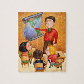 Teacher pointing to map, three children in desks puzzle