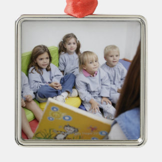 Teacher reading to students metal ornament