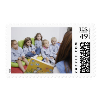 Teacher reading to students postage stamp