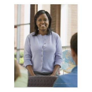 Teacher standing in classroom 2 postcard