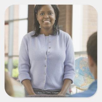 Teacher standing in classroom 2 square sticker