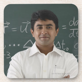 teacher standing in front of chalkboard, arms coaster