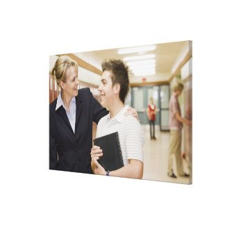 Teacher talking to student, hand on his shoulder canvas print