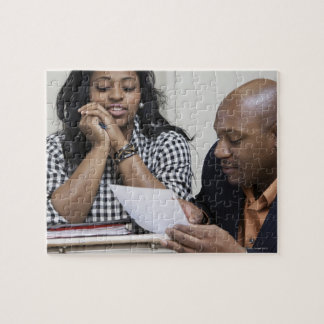 Teacher talking to student in classroom jigsaw puzzle