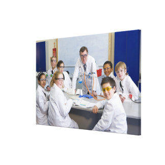 Teacher with his science class, all pupils canvas print