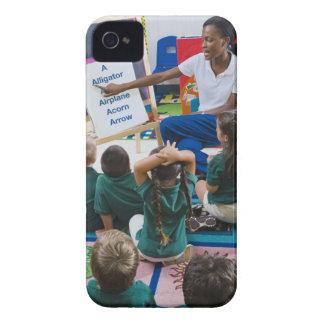 Teacher with preschool students in classroom iPhone 4 case