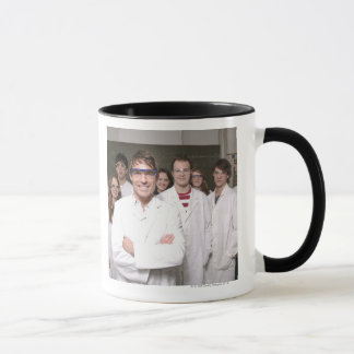 Teacher with students in science class mug