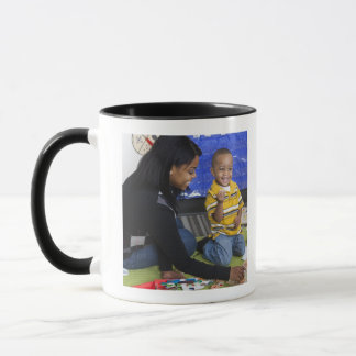 Teacher with toddler in daycare mug