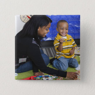 Teacher with toddler in daycare pinback button