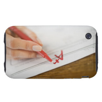 Teacher writing A plus grade on worksheet iPhone 3 Tough Cases
