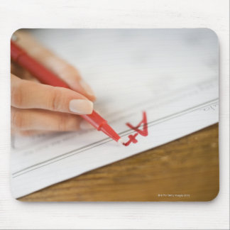 Teacher writing A plus grade on worksheet Mouse Pad