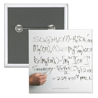 Teacher writing chemical formulae on white board 2 inch square button
